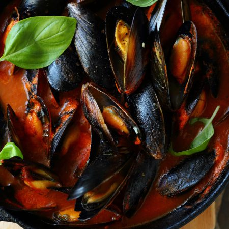 steamed mussels in pan, top